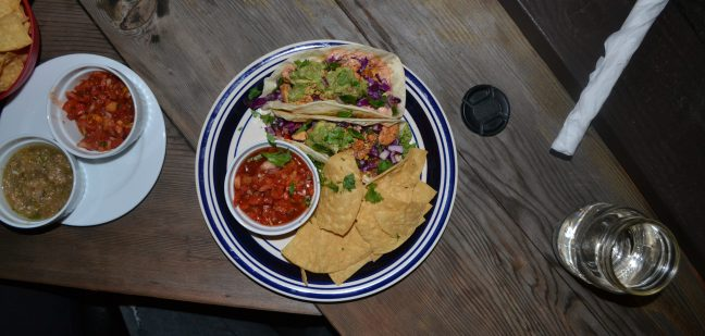 Chicken tacos served with chips and salsa